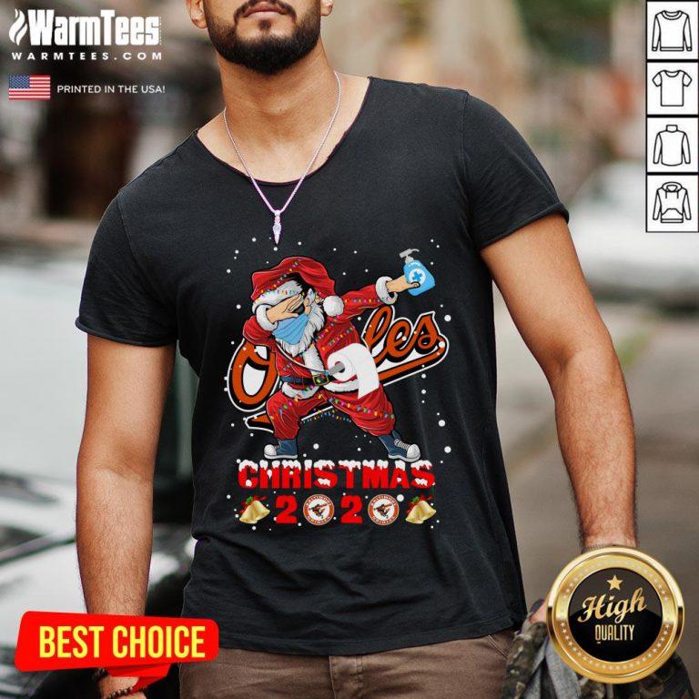 Cute Baltimore Orioles Funny Santa Claus Dabbing Christmas 2020 V-neck - Design By Warmtees.com